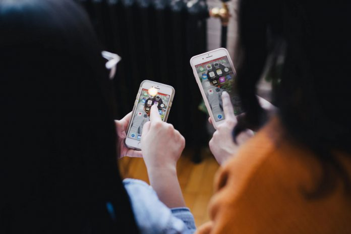 two women on their phones