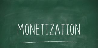 Monetization handwritten on school blackboard