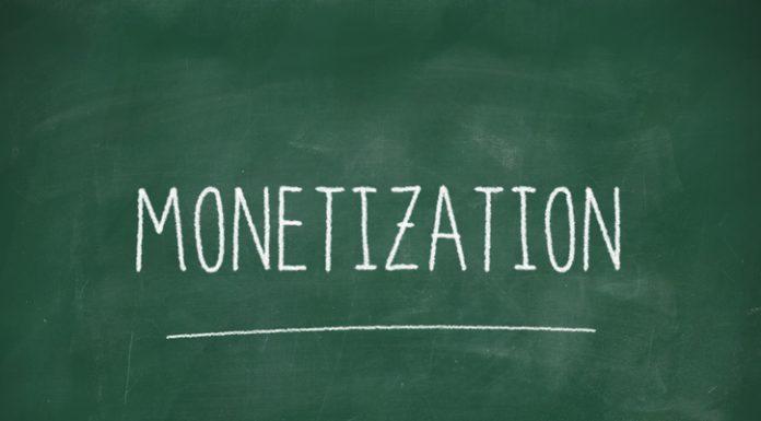Monetization handwritten on school blackboard