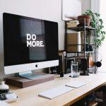 "apple monitor displaying ""do more"""