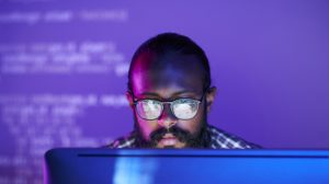 Programmer in front of monitor